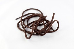 Brown color shoelaces, textile shoestring, shoe accessory, isolated object, design element