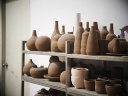 brown colour ceramic art and design  student's works in a design school pottery workshop