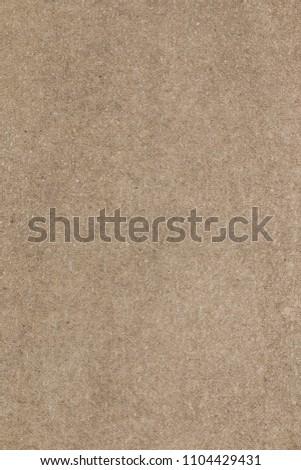Brown concrete floor texture. Close-up photo of scabrous background. Vertical orientation