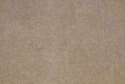 Brown concrete floor texture with small dash pattern. Close-up photo of scabrous background. Horizontal orientation