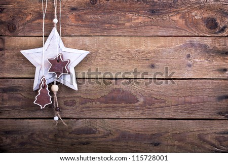 brown cookies with a white wooden star on a old rustic wooden board, christmas decoration