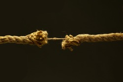 Brown cord on a black background