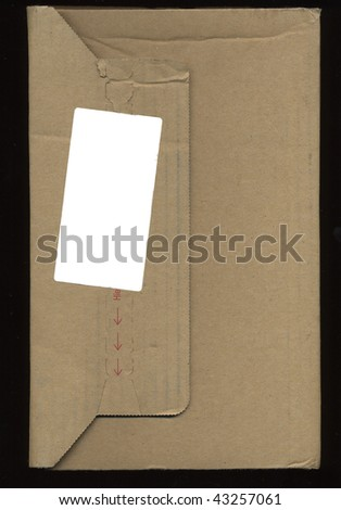 brown corrugated cardboard parcel isolated over black background