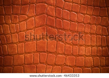 Brown corrugated leather surface (vignetted)