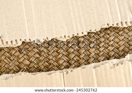 Brown Corrugated paper ripped on bamboo woven background