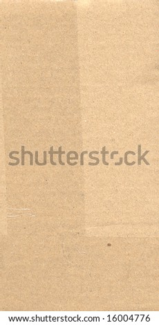 brown corrugated paperboard sheet background with nylon tape