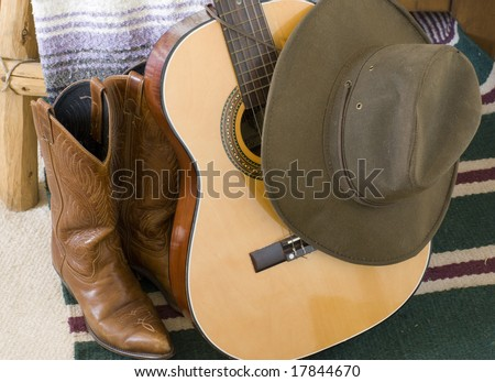 Cowboy hat and boots and guitar