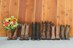 Brown cowboy boots bridesmaids with bouquet