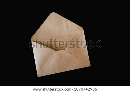 Brown craft envelope isolated on black background