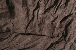 Brown crumpled natural linen cloth texture as background.