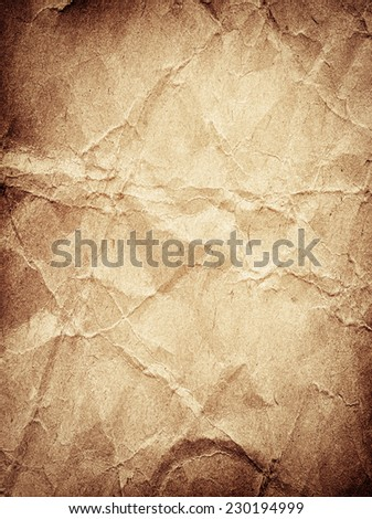 Brown crumpled paper texture in vertical position