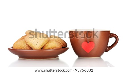 Brown cup with tea bag and heart-shaped cookies on brown plate isolated on white