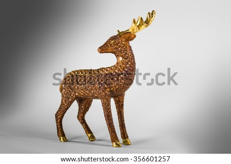 Stock Photo Brown decoration deer with golden shiny horn