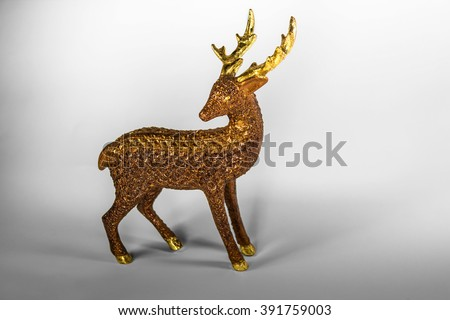 Stock Photo Brown deer decoration toy covered in gold glitter