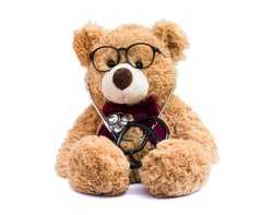 Brown doctor teddy bear with eye glasses and medical stethoscope isolated on white background.