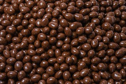 Brown dragee, chocolate covered nuts, background