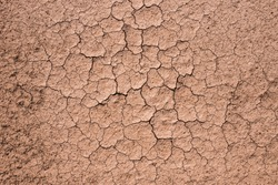Brown dry soil background At the top view