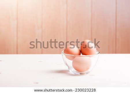 brown egg on a light wooden table side view