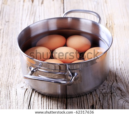 Brown eggs in a pan