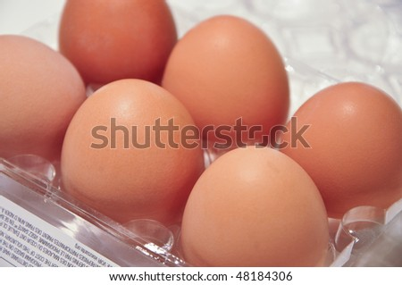 brown eggs in a tray