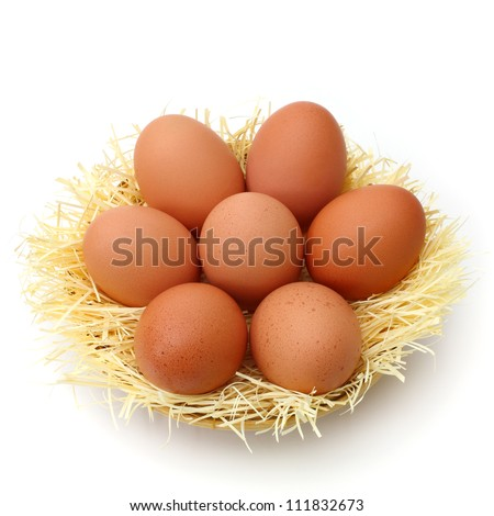 Brown eggs in the basket isolated on a white background