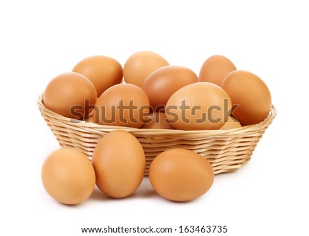 Brown eggs in the basket. Isolated on a white background