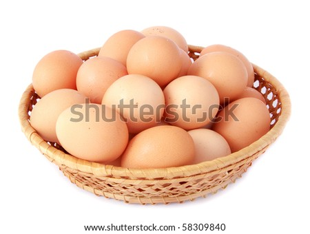 Brown eggs in the basket on white
