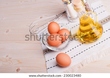 brown eggs with spices on a light wooden table top view and side view