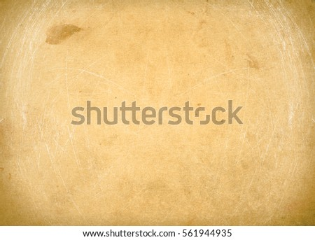 brown empty old vintage paper background. Paper texture - Shutterstock ID 561944935