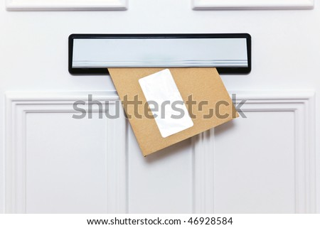 Brown envelope in a front door letterbox blank window for you to add your own name and address details.