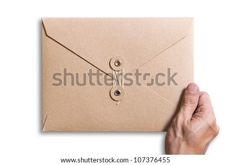 brown envelope with hand holding it