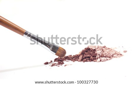 brown eyeshadow and brown makeup brush  isolated on white