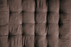 Brown fabric, sofa padding, texture, pattern. Close up brown color fabric texture. Flat lay, top view, copy space