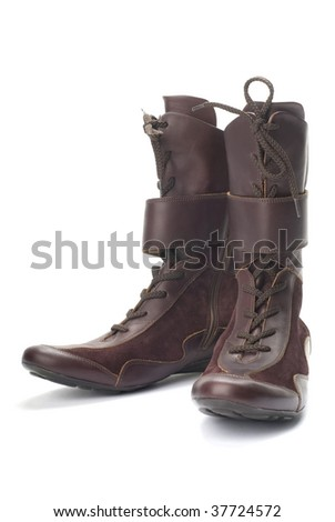 Brown female boots isolated on white background