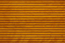 Brown fence wall of wooden planks vertical lines background, texture. Texture of wood lath wall background.