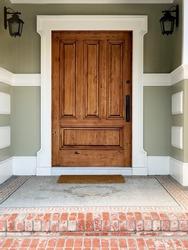 Brown front door, exterior shot of a house