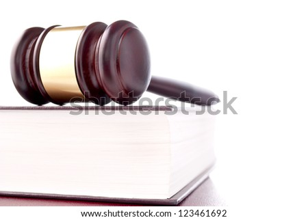 brown gavel with a brass band on a white background