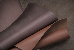 Brown genuine leather roll.real leather set. Leather in rolls.Hobby and craft material. leather texture close-up.Material for shoes, clothing and accessories