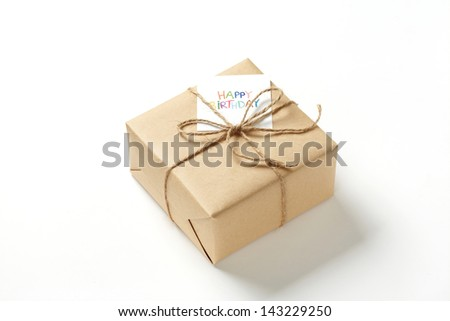 brown gift box on white background brown Gift box with brown ribbon.   - stock photo