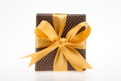 Brown gift box with dots with golden ribbon top view