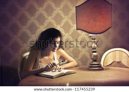 Brown girl reading a book, in an elegant location, with a magnifying glass