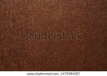 Brown glitter. Abstract shiny background. Design paper texture for decoration and design of Christmas, New Year or other holiday pictures. Beautiful packaging material.
