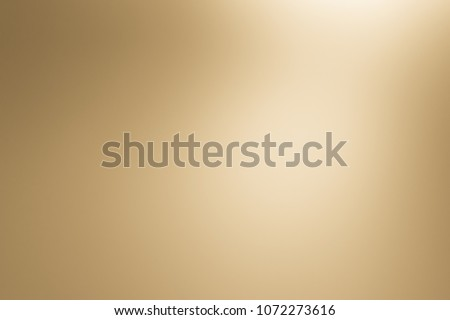 Brown gradient background gold abstract warm color elegant. Light cream texture design vintage luxury white blur golden old beige for christmas wallpaper or backdrop.