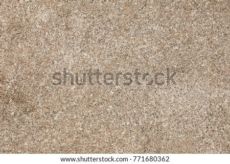 Brown granite rock background texture close up