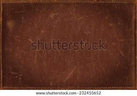 Brown grunge background from distress leather texture
