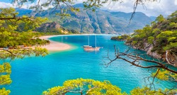 Brown gulet anchored at the Aegean sea - Panoramic view of Oludeniz Beach And Blue Lagoon, Oludeniz beach is best beaches in Turkey - Fethiye, Turkey