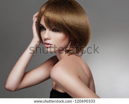 Brown Hair. Beautiful Woman with Bob Hairstyle . High quality image.