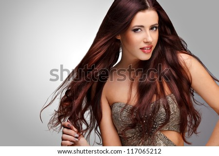 Brown Hair. Beautiful Woman with Healthy Long Hair.