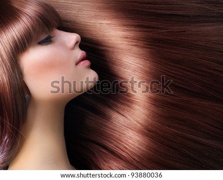 Brown Hair. Beautiful Woman with Healthy Long Hair - stock photo