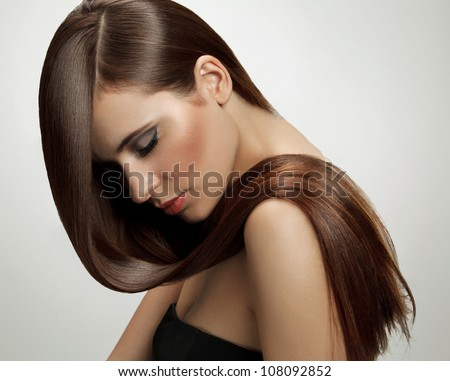 Brown Hair. Beautiful Woman with Healthy Long Hair. High quality image. - stock photo